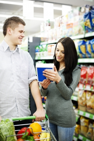 Young couple shopping at supermarket photo