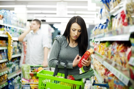 Young couple shopping at supermarket Stock Photo - 18161959