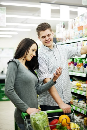 Couple at supermarket photo