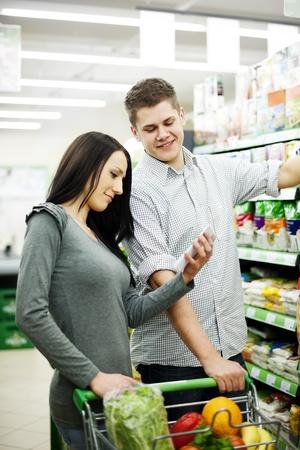 Couple at supermarket Stock Photo - 18161924