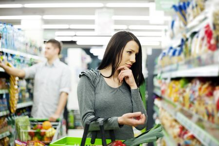 Couple at supermarket Stock Photo - 18161197