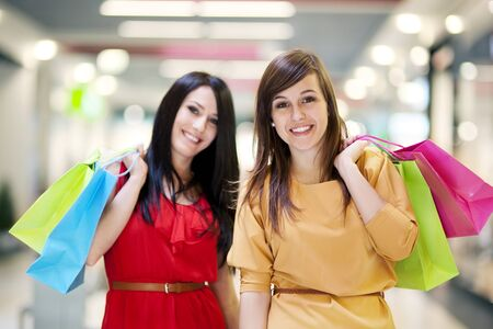 Two girlfriends with shopping bags  photo