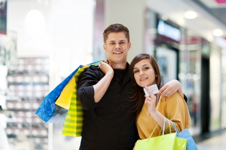 gift spending: Young couple with shopping bags Stock Photo