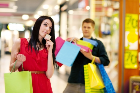 Young woman spending too much money for shopping photo
