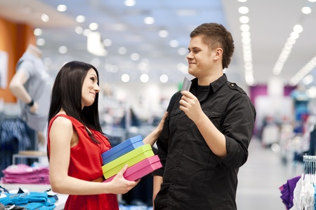 spoiling: Man spoiling his girlfriend by buying her new clothes Stock Photo