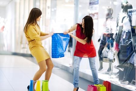 women fighting: Fight for shopping bag Stock Photo