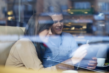 Young couple using tablet in coffee shop Stock Photo - 18161111