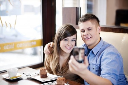 Couple taking picture in cafe Stock Photo - 18161936