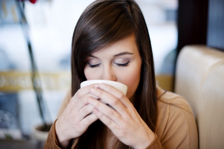 Close up of woman drinking coffee Stock Photo - 18161245