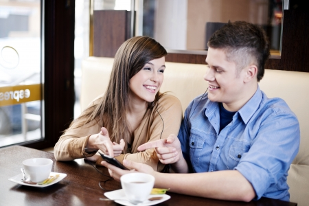 Couple listening music in cafe photo