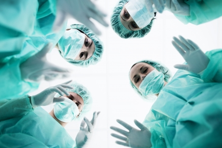 Surgeons standing above of the patient before surgery photo