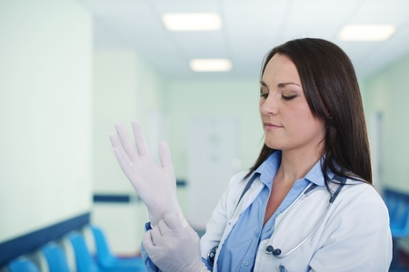 surgical nurse: Female doctor wearing surgical gloves