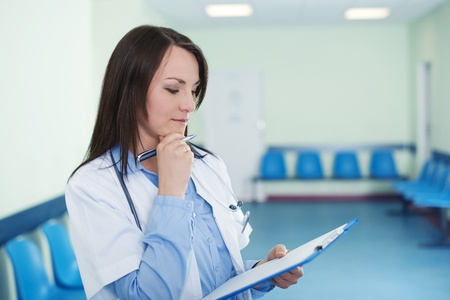 Female doctor checking medical results Stock Photo - 18182347