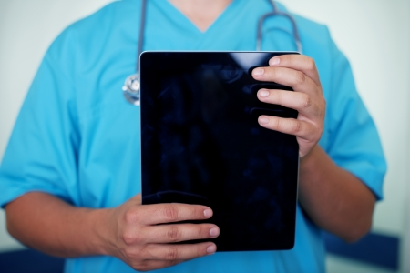 Doctor holding digital tablet Stock Photo - 18182384