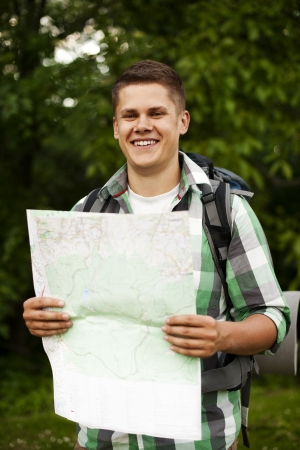 outdoor pursuit: Man holding a map in forest
