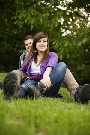 Young couple sitting on glade photo