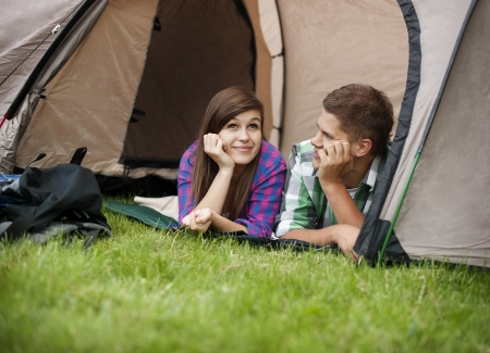 Couple resting in tent photo