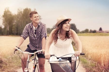 bicycle lane: Happy couple riding bicycles Stock Photo