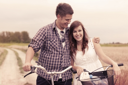 first love: Lovers with bicycles Stock Photo