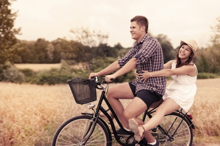 affectionate action: Couple have fun riding on bike