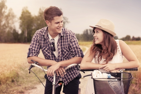 love at first sight: Portrait of happy couple on bicycles