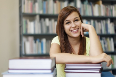 college building: Portrait of young student woman in library