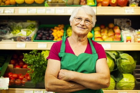 one senior woman only: Portrait of mature store worker