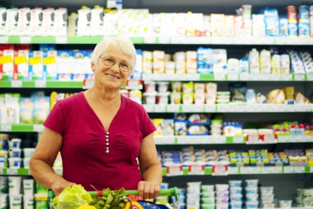 Portrait of senior woman at supermarket photo