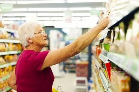 Senior woman at supermarket  photo