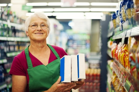 Senior woman working at supermarket  photo