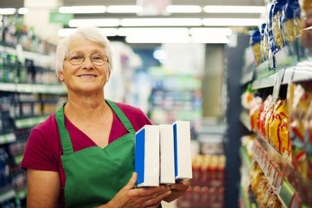 one senior woman only: Senior woman working at supermarket