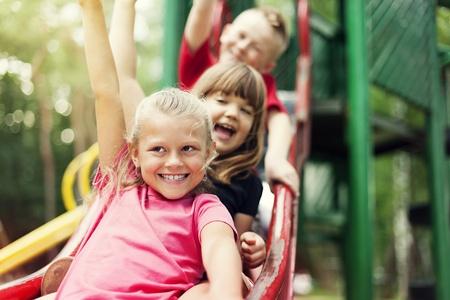 exhilaration: Children on slide