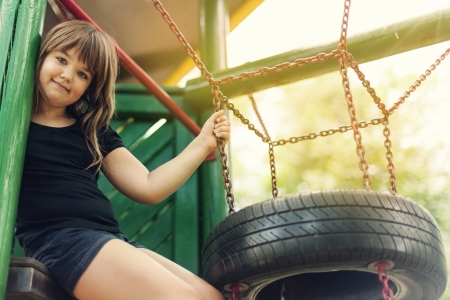 8 years: Portrait of happy, little girl on playground Stock Photo