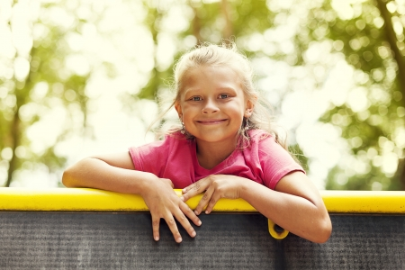 8 9: Portrait of little girl on playground Stock Photo