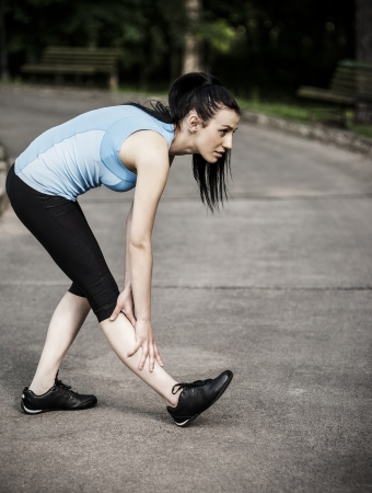 Young woman stretching photo