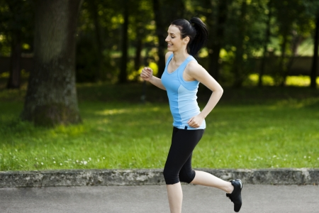 Active woman jogging Stock Photo - 18184378