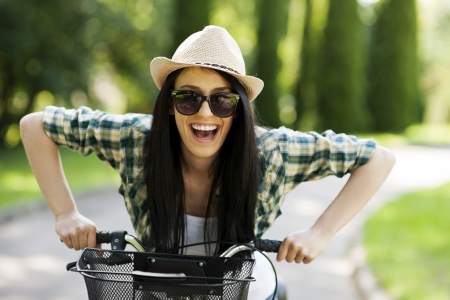 outdoor pursuit: Happy young woman with bicycle Stock Photo