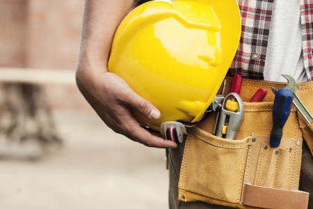 tools belt: Close-up of hard hat holding by construction worker