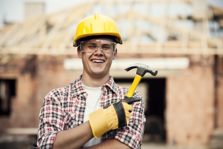 construction safety: Construction worker with hammer