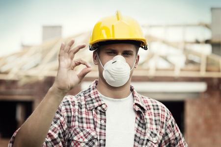 Manual worker with hard hat and protective mask Stock Photo