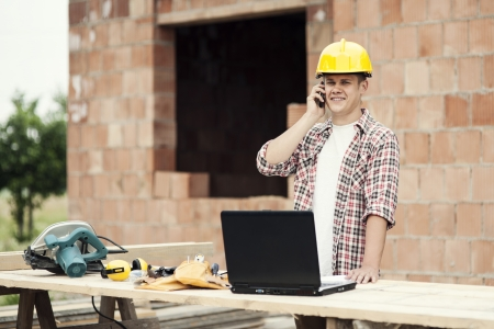Carpenter talking on mobile phone Stock Photo - 18184844