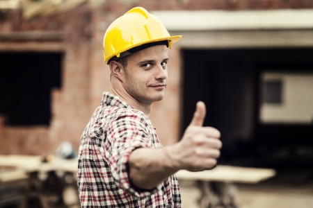 Construction worker gesturing thumbs up photo