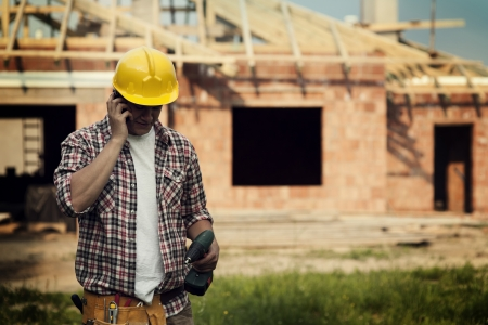 Construction with mobile phone Stock Photo - 18184885