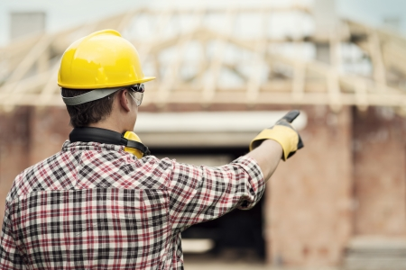 Construction worker pointing at something Stock Photo - 18184892