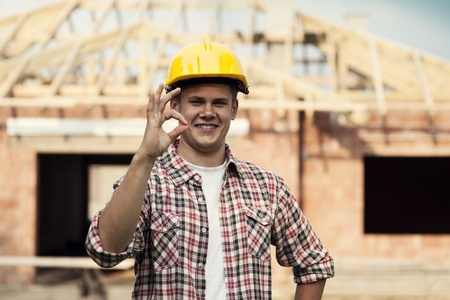 Construction worker showing ok sign photo