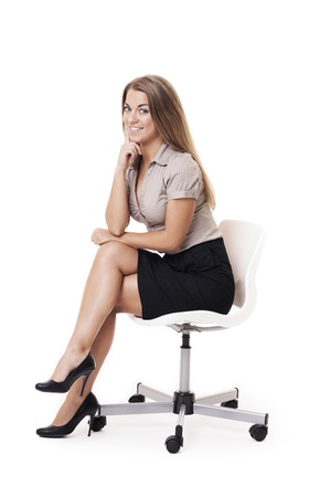 Smiling woman sitting on office chair photo