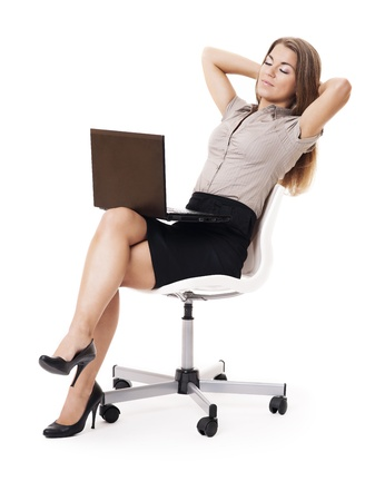 woman skirt: Businesswoman with laptop relaxing on office chair