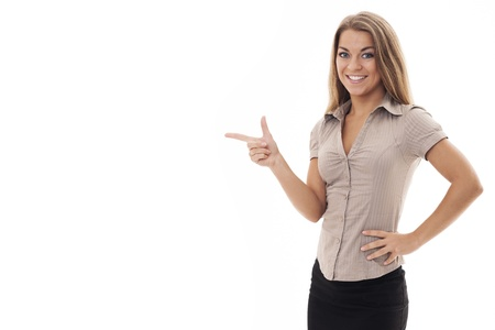 woman pointing: Beautiful businesswoman pointing at copyspace