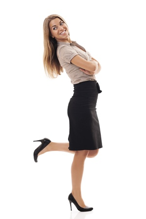 Successful businesswoman kicking up foot photo