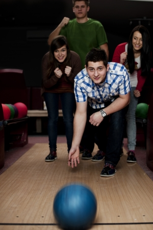 bowling alley: Friends bowling together